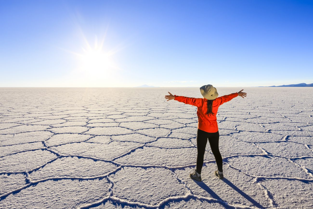 Female tourist on Salar de Uyuni, Altiplano, Bolivia