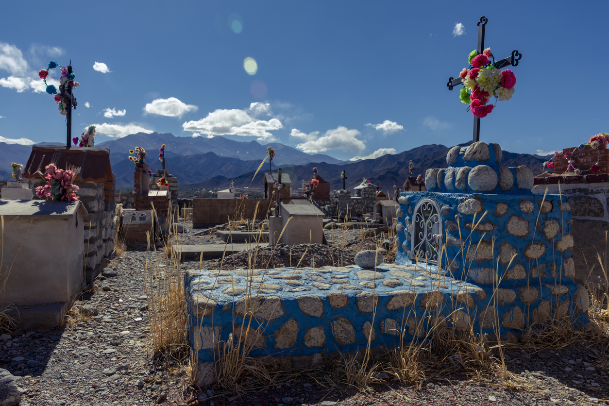 Colorful tombs in an old cemetery in the top of a mountain in Cachi, Salta, Argentina