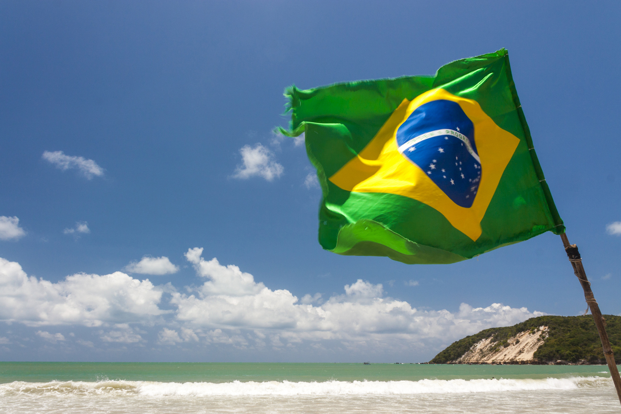Brazilian Waving flag in Ponta Negra dunes beach in Natal, Brazil